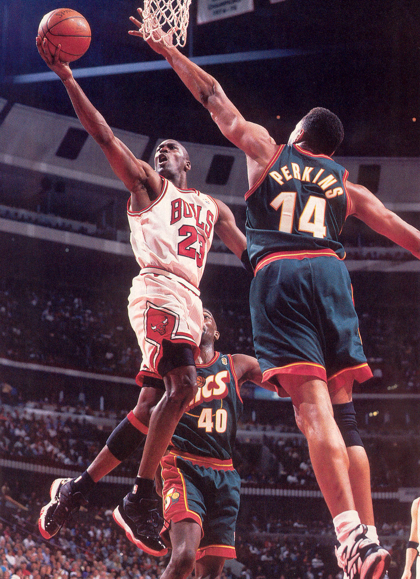 59c1ab1cc6c0 Michael Jordan wearing his player-exclusive black red Air Jordan XI low in  the  96 NBA Finals against the Seattle Supersonics